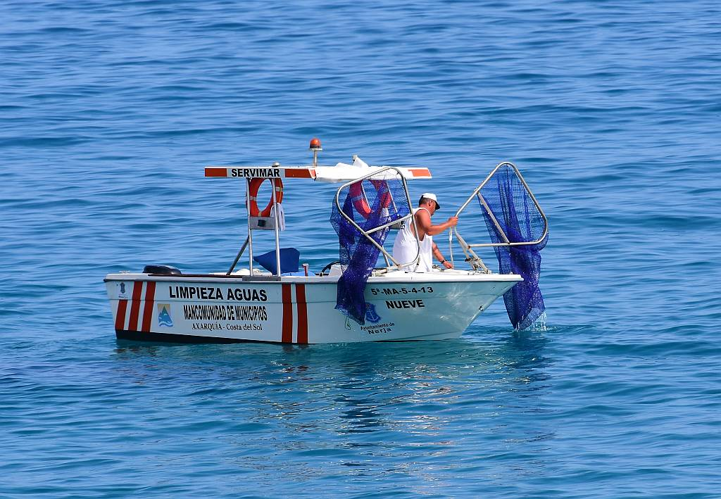 Cleaning boats, Nerja